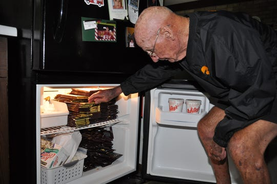 Bob Williams keeps his refrigerator heavily stocked with king-sized candy bars to hand out on his daily rounds of kindness in his hometown of Long Grove, Iowa.