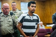 Cristhian Bahena Rivera, 24, is escorted out of the courtroom after pleading not guilty to the charge of first-degree murder in the death of Mollie Tibbetts on Wednesday, Sept. 19, 2018, at the Poweshiek County Courthouse in Montezuma.