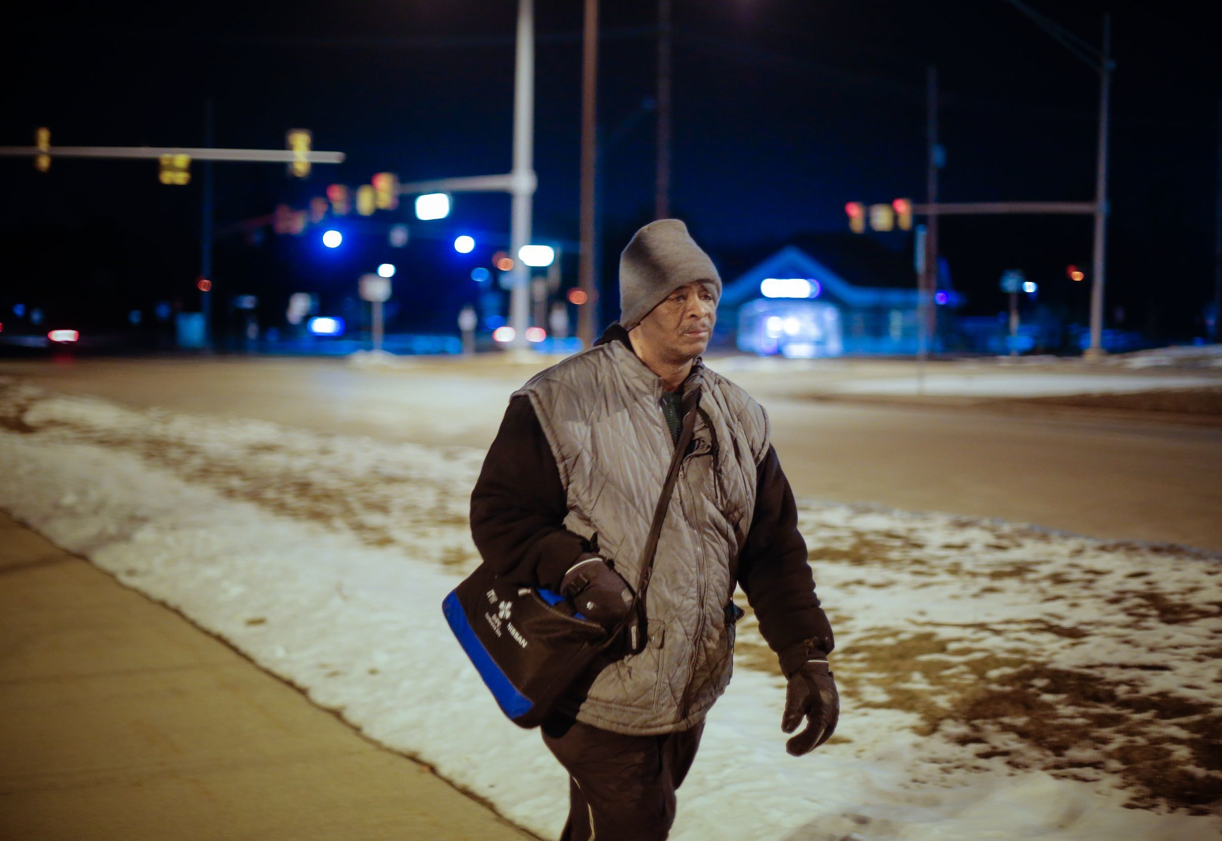 James Robertson makes his way along Crooks Road after working his shift at Schain Mold & Engineering in Rochester Hills on Friday January 9, 2015. Robertson's story of walking 21 miles for work shined a spotlight on southeast Michigan's dysfunctional public transportation system.