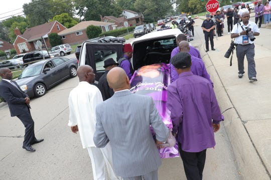The casket of Fitzgerald High School student Danyna Gibson is loaded into a hearse following her funeral service at New St. Paul Missionary Baptist Church in Warren on Wednesday, September 19, 2018.