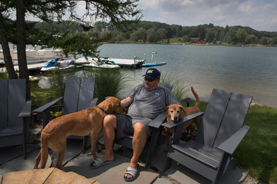 Stan Van Gundy of Clarkston spends time in Clarkston with Opie, right and Eastwood, a red Lab mix he and his family rescued from the Little Traverse Bay Humane Society. This is the seventh dog that the Van Gundys have adopted through the years.