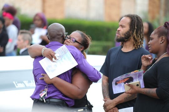 People hug following funeral services for Fitzgerald High School student Danyna Gibson held at New St. Paul Missionary Baptist Church in Warren on Wednesday, September 19, 2018.