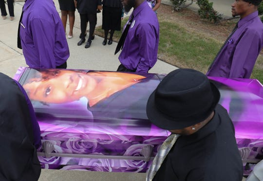 The casket of Fitzgerald High School student Danyna Gibson is carried to a waiting hearse following her funeral service at New St. Paul Missionary Baptist Church in Warren on Wednesday, September 19, 2018.