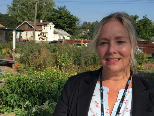 Saskia Thompson, executive director of the Detroit Land Bank Authority, photographed Sept. 18, 2018 at the Warrendale neighborhood community garden, which was created on vacant lots purchased from the Land Bank.