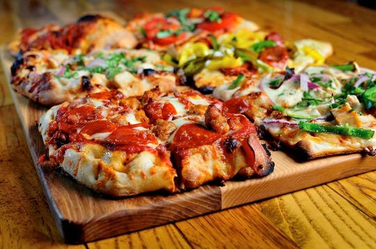 The Mitten Brewing Company in Grand Rapids offers endless snack choices and pizza toppings.