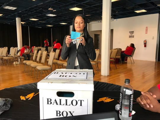 A UNITE HERE Local 24 member and employee of Westin Book Cadillac votes to authorize a strike.
