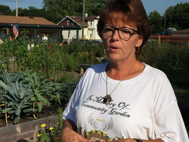 Barb Matney at the Warrendale community garden she helped create on vacant lots purchased from the Detroit Land Bank Authority. Photo taken Sept. 18,2018.