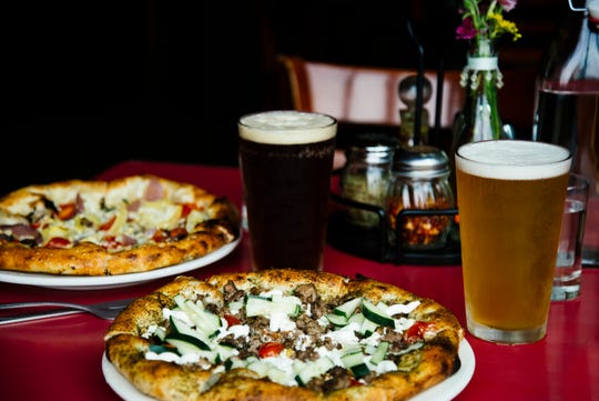 You can build your own pizza any way you like at Motor City Brewing Works in Detroit, but guests recommend the fuego and barbecue pizzas.