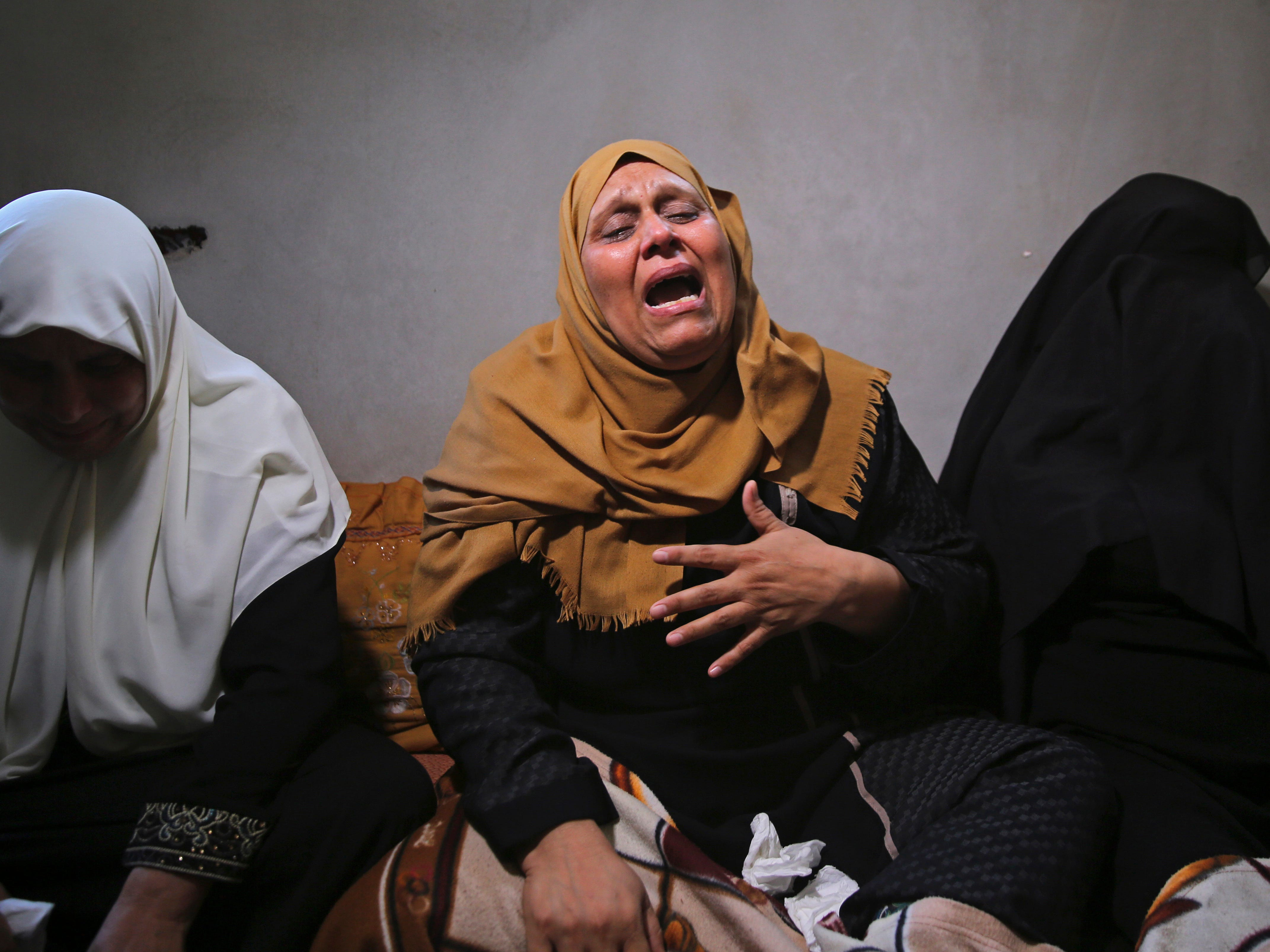The mother of Ahamd Omar, 20, mourns while waiting with relatives for the body of her son at the family's house during his funeral in the Shati refugee camp, Wednesday, Sept. 19, 2018. Omar was killed Tuesday during a protest at the entrance of Erez border crossing between Gaza and Israel.