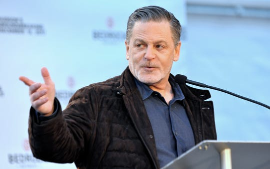 """Billionaire Dan Gilbert, the Cleveland Cavaliers owner and a driving force in downtown Detroit's revival, is part of a group that's in """"final negotiations"""" to buy Sports Illustrated, according to a report from the New York Post."""