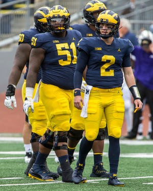 Cesar Ruiz (51) and Shea Patterson