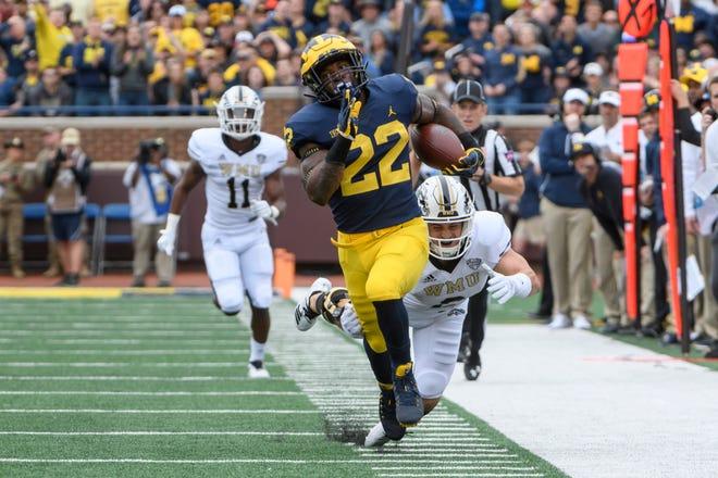 Karan Higdon leads Michigan in rushing with 228 yards.