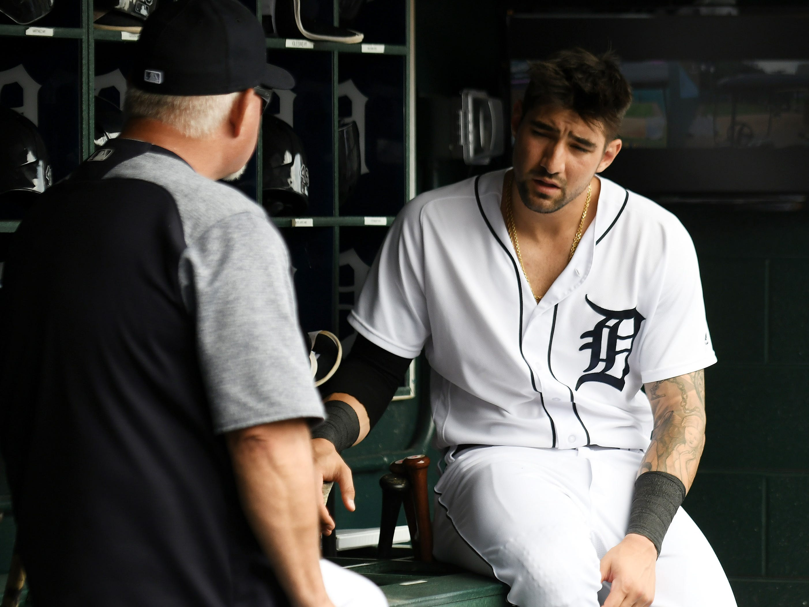 Tigers manager Ron Gardenhire, left, talks with Nicholas Castellanos in the fourth inning.