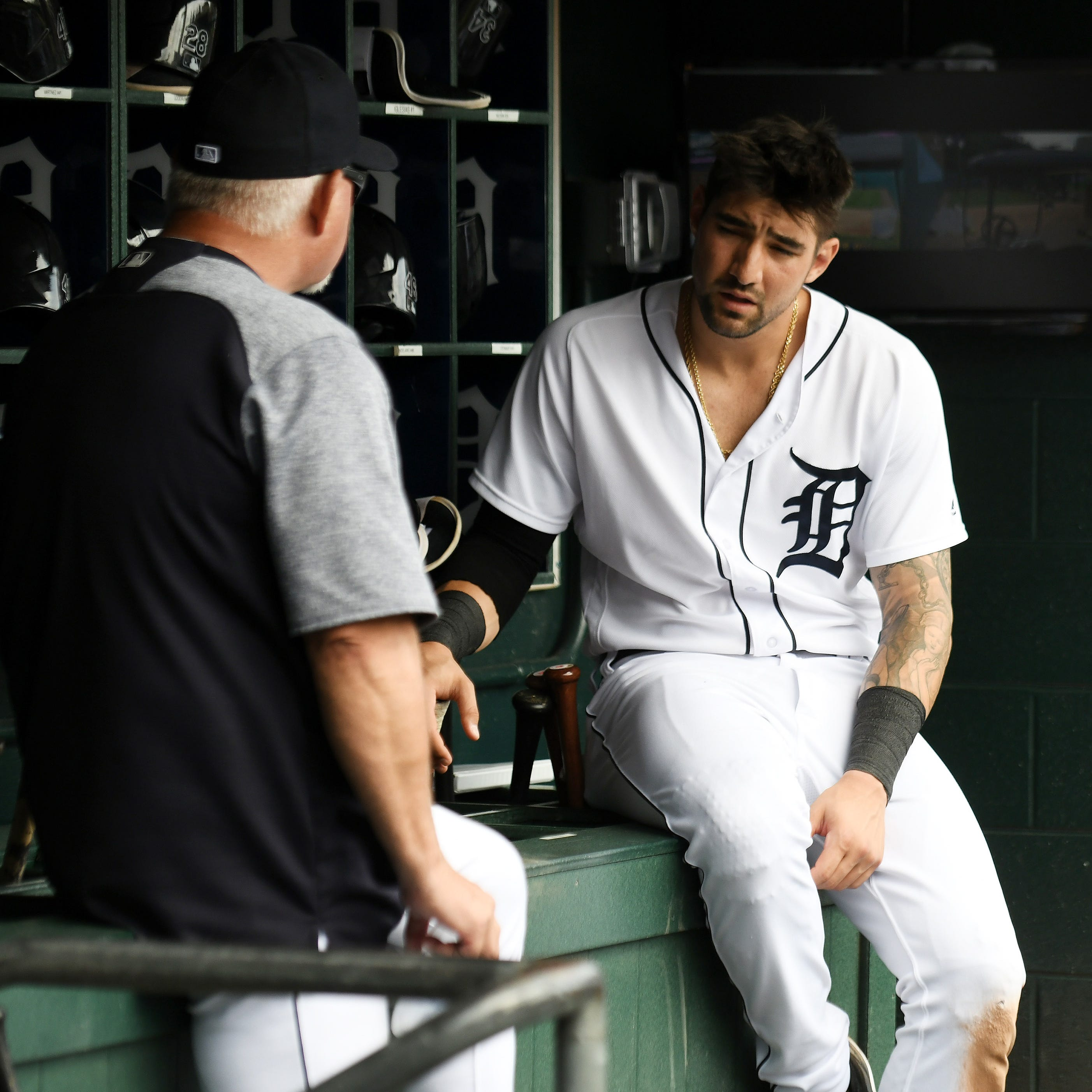 Tigers manager Ron Gardenhire, left, talks with...