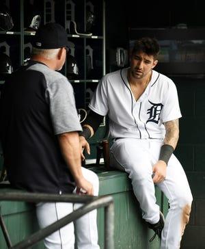 Tigers manager Ron Gardenhire, left, talks with Nicholas Castellanos last season.