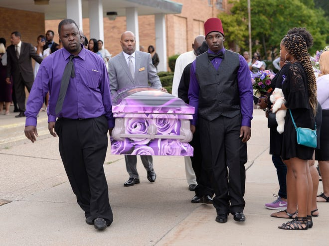 Pallbearers carry the casket of Danyna Gibson to the hearse after her funeral service at New St. Paul Missionary Church in Warren.. September 19, 2018., in Warren, Mich.