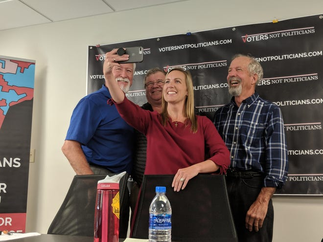 From left: Mickey Knight, Rick Johnson, Barb Byrum and Bill Bobier pose for a selfie at a Voters Not Politicians press conference.