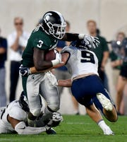 Michigan State running back LJ Scott is averaging 3.4 yards per carry through two games this season.