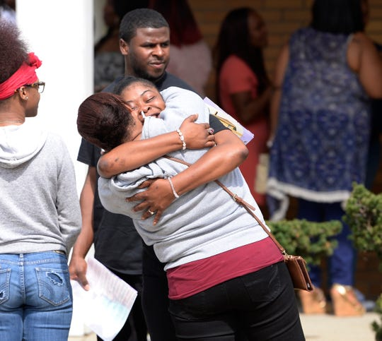 Family members and friends mourn the death of Danyna Gibson at the end of her funeral service in Warren Wednesday.