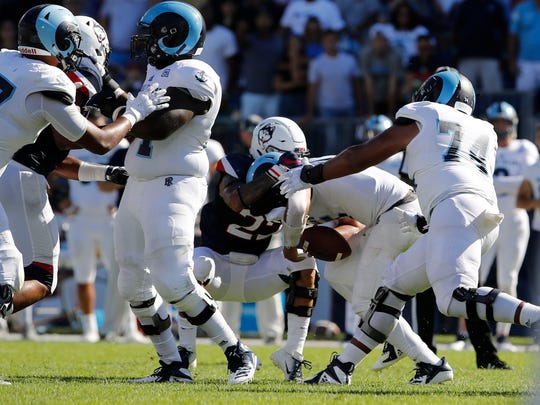 Connecticut Huskies linebacker Eli Thomas (22) sacks Rhode Island Rams quarterback JaJuan Lawson to end the game in the second half at Pratt & Whitney Stadium at Rentschler Field on Sept. 15.
