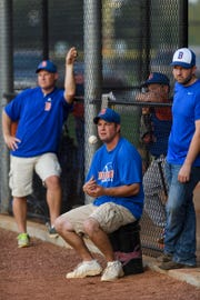 Bases Loaded Bombers Head Coach Ryan Hartwick, left, and Assistant Coaches Karl Britton, center, and Charles Sample, right, watch their team take on the River City Aces at Deaconess Sports Park in Evansville, Ind., Tuesday, Sept. 18, 2018.