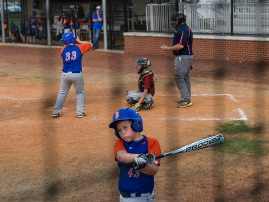 Bases Loaded Bombers player Brody Clark (43) warms-up as he waits for his turn to bat during an Indiana USSSA fall ball travel league match against the River City Aces at Deaconess Sports Park in Evansville, Ind., Tuesday, Sept. 18, 2018.