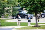 Law enforcement officials work the scene of a shooting at a Middleton office building