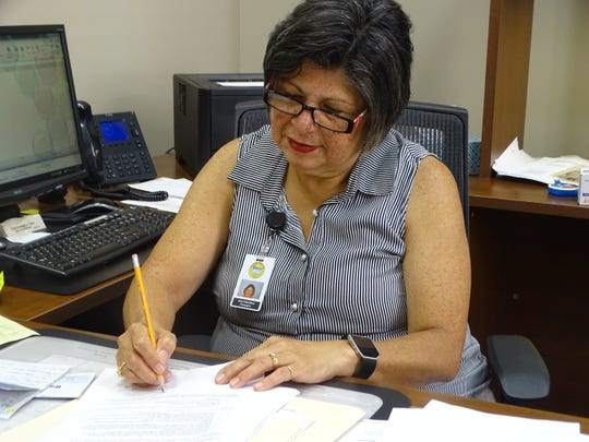 Sandusky County Treasuer Irma Celestino, seen here in her office Wednesday, is retiring at the end of September. She has served as treasurer for 13 years and worked for Sandusky County a total of 45 years.