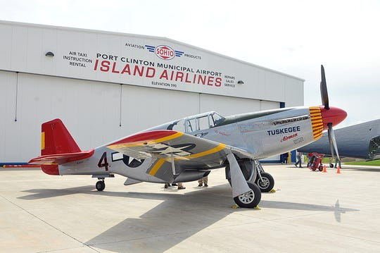 A restored P-51C Red Tail Mustang fighter plane like the one Harold Brown and the Tuskegee Airmen flew during World War II visited the Liberty Aviation Museum in 2014 and 2017.