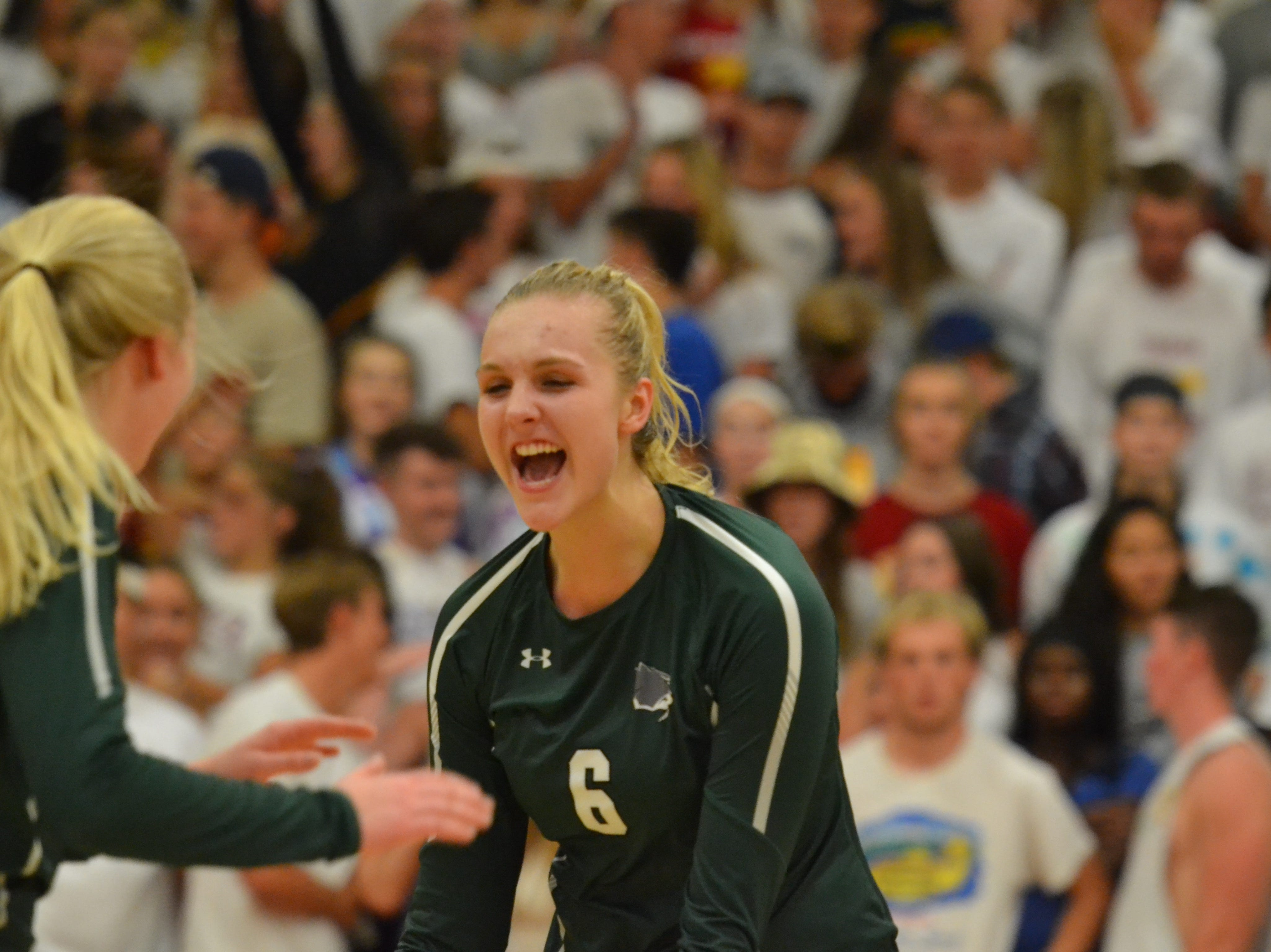 Fossil Ridge's Riley Zuhn celebrates a point during Tuesday night's 3-1 volleyball loss to Fossil Ridge at Rocky Mountain.