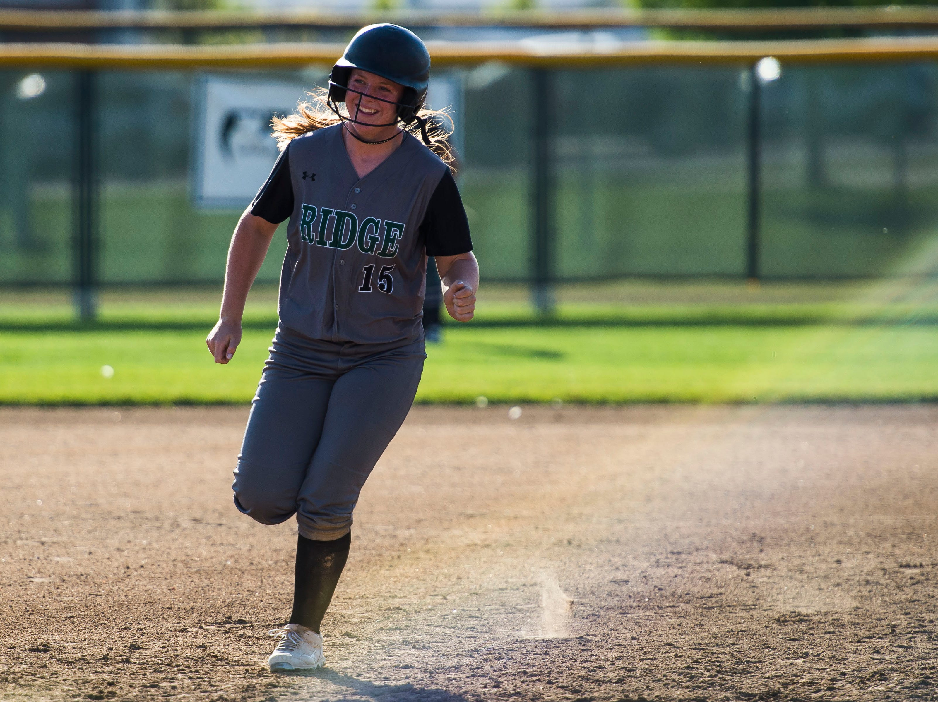 Fossil Ridge High School senior outfielder Mia Moddelmog (15) rounds the bases after hitting a grand slam against Fort Collins High School relief pitcher Mason Togher (16) on Tuesday, Sept. 18, 2018, at Fossil Ridge High School in Fort Collins, Colo.