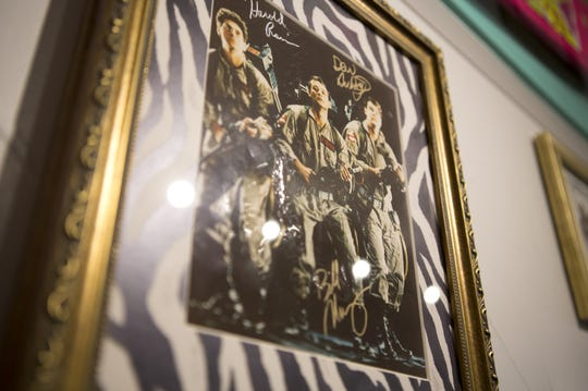 A signed photo of Harold Ramis, Bill Murray and Dan Aykroyd as the Ghostbusters at Totally 80's Pizza. This and other Halloween-centric pieces of 1980s memorabilia will be on display in October at the restaurant and museum.