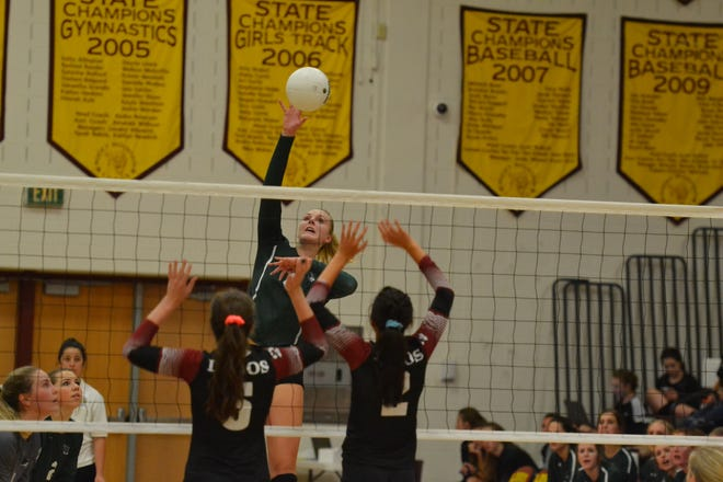 Fossil Ridge High School volleyball player Riley Zuhn, shown making a kill in a loss at Rocky Mountain, and her teammates will host Loveland in a 6:30 p.m. match Tuesday night.