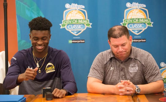 Lehigh Senior High School basketball player Quinton Desamours, left, and coach Greg Coleman express their excitement to play in the Sunshine Series of the City of Palms Classic during a press conference on Wednesday at the Crowne Plaza Fort Myers at Bell Tower Shops in south Fort Myers. The tournament begins Dec. 17.