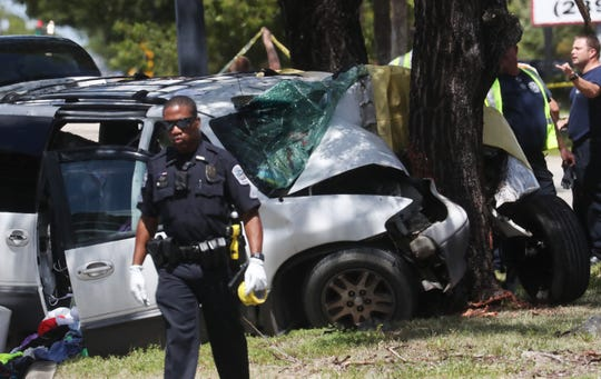Emergency officials work the scene of a fatal vehicle crash on Fowler Street in Fort Myers on Wednesday, Sept. 19, 2018.