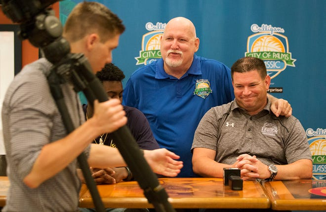 City of Palms Classic's Donnie Wilkie, center, welcomes Lehigh Senior High School basketball coach Greg Coleman, right, to the annual basketball tournament during a press conference on Wednesday at the Crowne Plaza Fort Myers at Bell Tower Shops in south Fort Myers. The tournament begins Dec. 17.