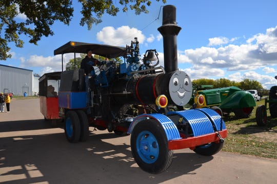 A steam engine wagon provided by the Rabas family gives rides to visitors to last year's Agricultural Heritage Days. The steam wagon will return to this year's event.