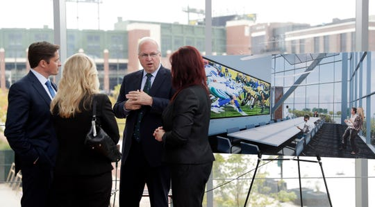 Breakthrough Fuel founder Craig Dickman, facing camera, has been named the innovation center's managing director at TitletownTech a business innovation center across from Lambeau Field in Green Bay.