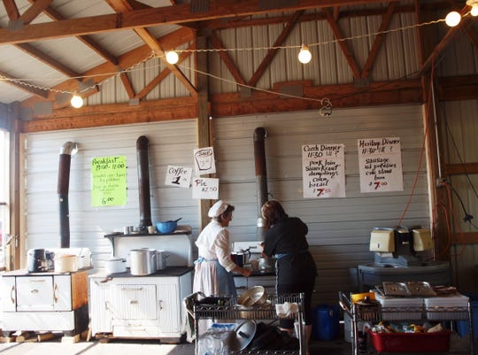 Volunteers cook food to be served at Agricultural Heritage Days on these old-fashioned, wood-fueled cookstoves that are considered one of the highlights of the event.
