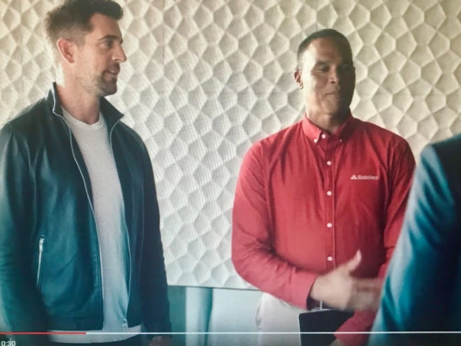 "Aaron Rodgers, left, stars in a new State Farm campaign titled ""Agent vs. Agent."""