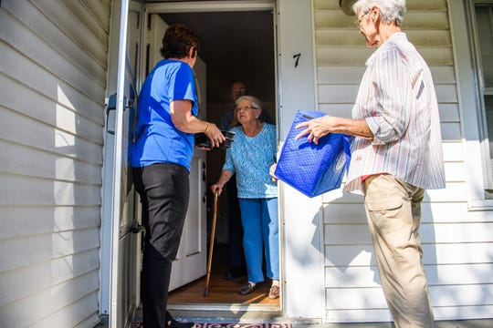 Executive director of Meals on Wheels of Greenville Catriona Carlisle, left, and volunteer Barbara Burgess deliver their 12 millionth meal to Virginia and Cecil Rollins on Wednesday, Sept. 19, 2018.