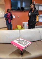 Kaimora Smith, 13, left, of Mauldin talks with her mother, Sharee Gray, after she got a Doppler brain scan from Dr. Alan Anderson at the Cancer Institute of Greenville Health System in Greenville in September.