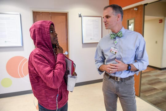 Kaimora Smith, 13, of Mauldin chats with Dr. Alan Anderson after getting a Doppler brain scan at the Cancer Institute of Greenville Health System in Greenville in September. Dr. Anderson is the medical director for the Comprehensive Sickle Cell Disease Program at the hospital.