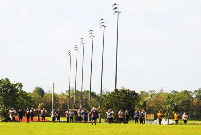 The George Washington High School Geckos wind down practice Sept. 18 at the GW upper field. GW athletic director Marty Boudreau announced the lights were good to go for high school football games this weekend.