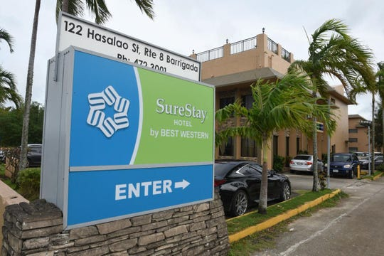 A new sign on the former Palmridge Inn shows it is now SureStay Hotel by Best Western