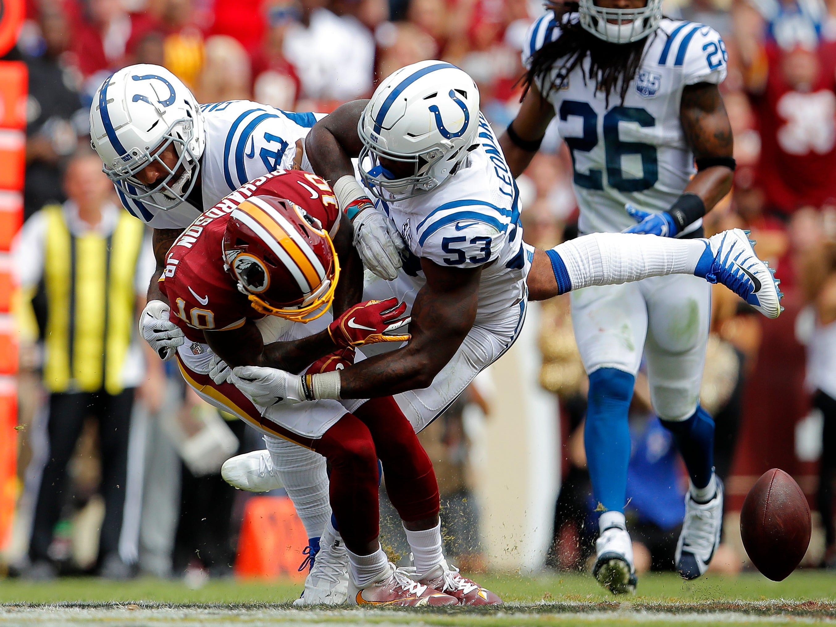Indianapolis Colts defensive back Matthias Farley (41) joins Darius Leonard (53) in tackling Washington Redskins wide receiver Paul Richardson on Sept. 16, 2018.