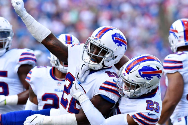 Sep 16, 2018;  Buffalo Bills defensive back Vontae Davis (22) and defensive back Micah Hyde (23) celebrate making a stop on third down during the first quarter against the Los Angeles Chargers at New Era Field.