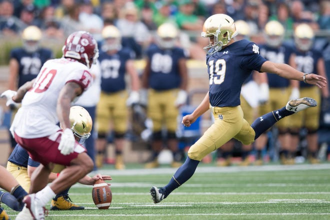 Notre Dame Fighting Irish kicker Justin Yoon (19) attempts a third quarter field goal against the Temple Owls at Notre Dame Stadium.