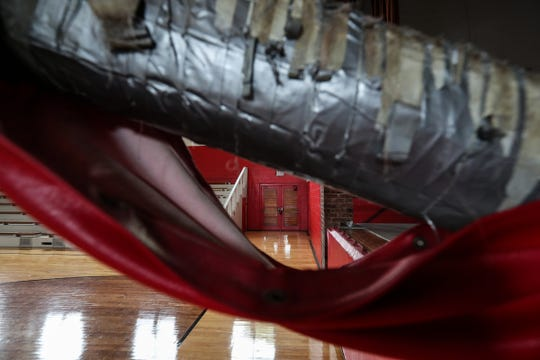 One hoop at the gymnasium is supported by duct-taped beams.