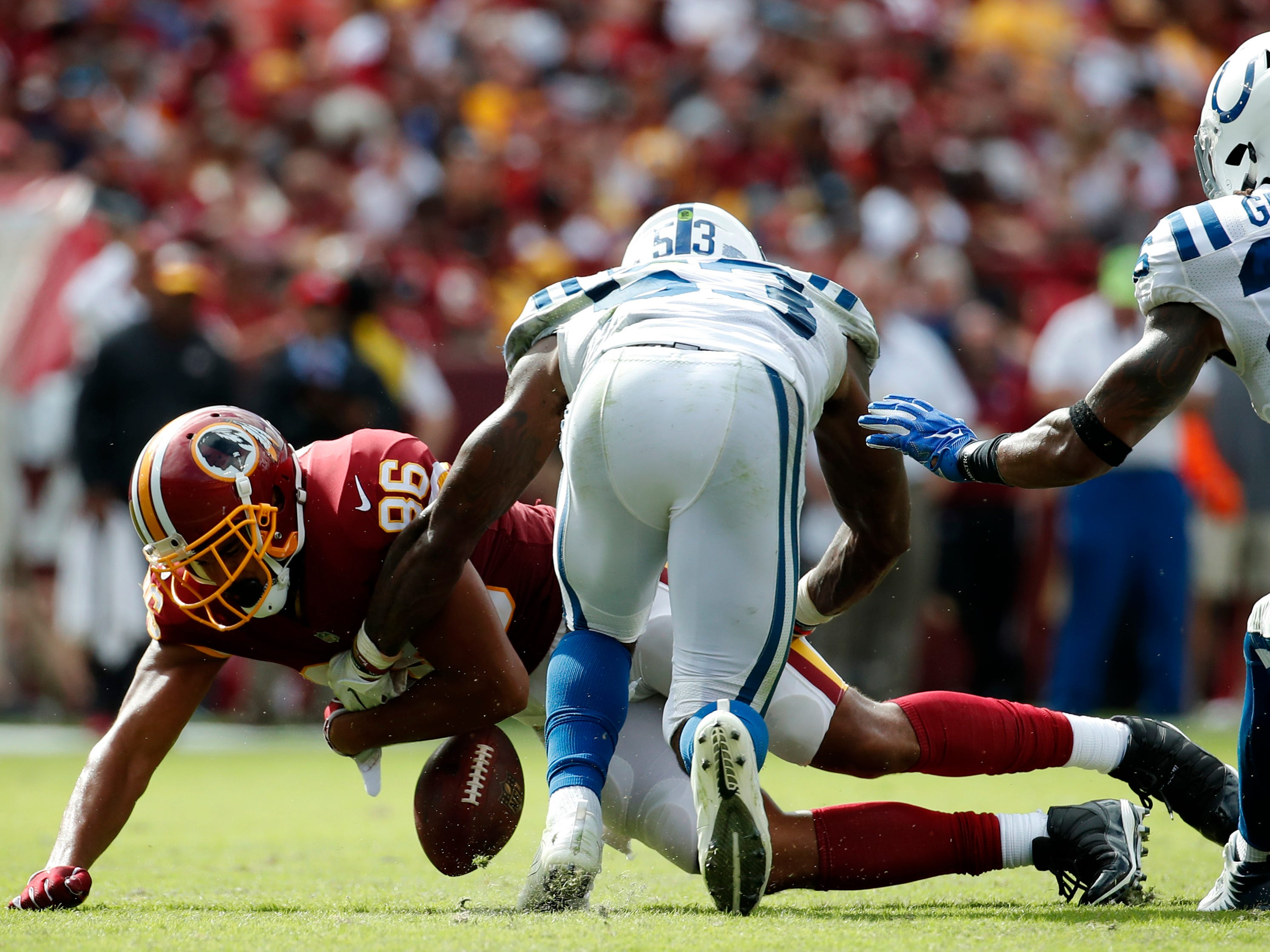 Washington Redskins tight end Jordan Reed fumbled as Darius Leonard (53) made the tackle in  their game on Sept. 16. Leonard recovered the fumble.